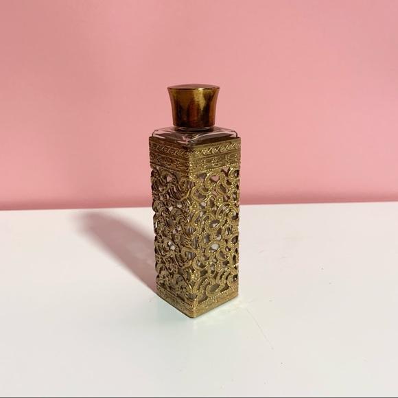 Vintage ornate brass empty bottle
